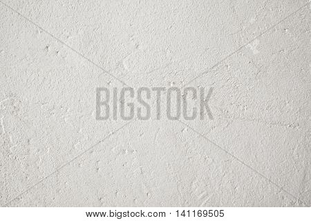 Grungy gray background, free space. Old uneven white wall backdrop