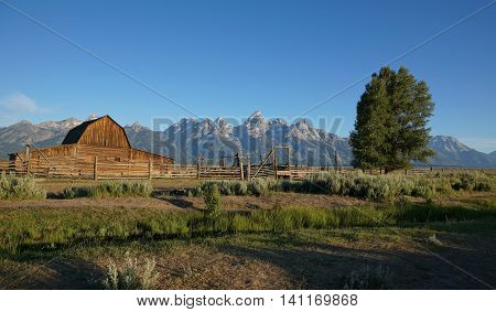 Mormon Row cabin against Grand Tetons backdrop