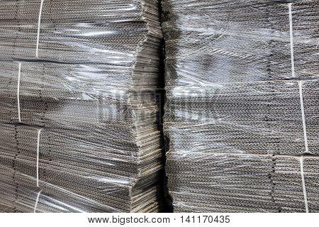 corrugated cardboard packaging in cellophane