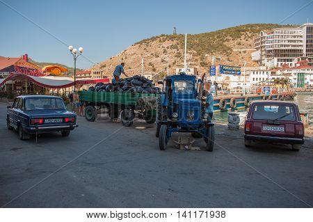 BALAKLAVA CRIMEA. UKRAINE - JULY 25 2010: garbage collection on the waterfront