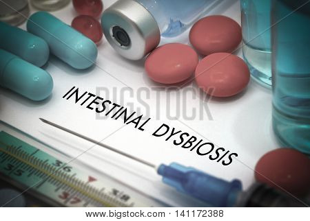 Intestinal dysbiosis. Treatment and prevention of disease. Syringe and vaccine. Medical concept. Selective focus