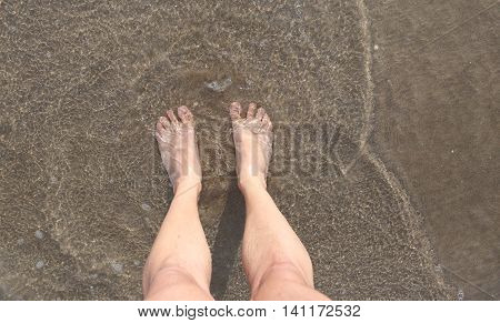 two big barefoot by the sea in summer