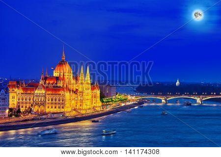 Hungarian Parliament And Margaret Bridge At Night. Budapest. Hungary.