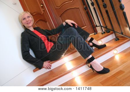 Blond Woman On Office Stair