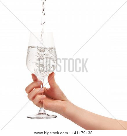 Water Pouring Into Full Wine Glass In Woman's Hand