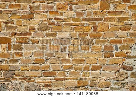 The texture of the walls of the ancient fortress tower. Architecture exterior background