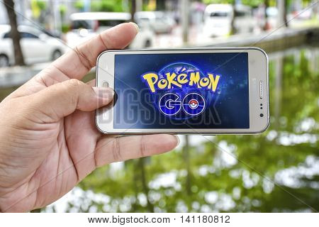Bangkok Thailand - August 3 2016: Pokemon Go logo on the phone. Pokemon Go is a location-based augmented reality mobile game.