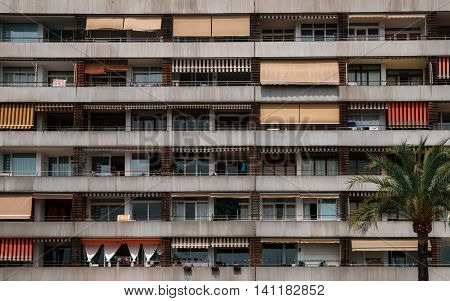 Texture of multistorey apartment house wall with balconies and windows in the resort of Palma de Mallorca