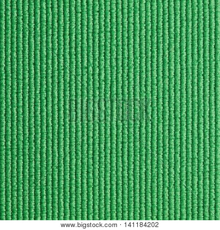 Closeup detail of green yoga mat texture background