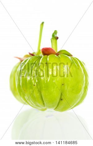 Close Up Garcinia Cambogia With Reflection On White Background.