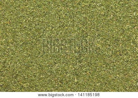 Organic dry Moringa or Sahjan (Moringa oleifera) leaves in tea cut size. Macro close up background texture. Top view.