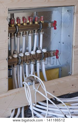 Detail of new floor heating system in wooden house.