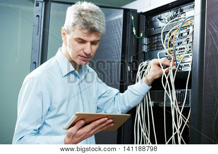 network engineer administrator in server room