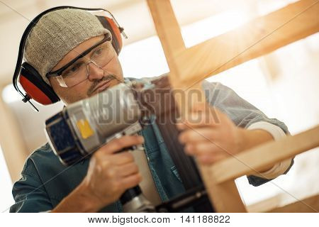 Close up of a young carpenter at work.