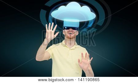 3d technology, virtual reality, cyberspace, entertainment and people concept - happy young man with virtual reality headset or 3d glasses playing game and looking at cloud icon over black background