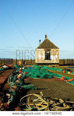 Fishing Nets drying on the quayside at Maryport Harbour Maryport Cumbria England
