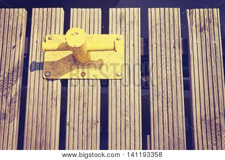 Yellow Mooring Bollard On Wooden Pier.