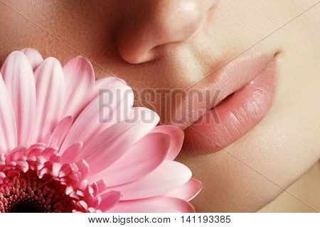Lips With Flower. Close-up Beautiful Female Lips With Bright Lip