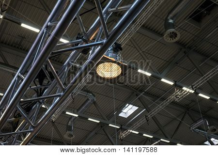 Ceiling of the room with a metal construction and ventilation