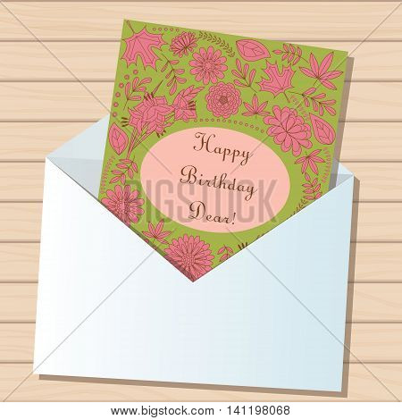 Vector happy birthday dear card in envelope on wooden background