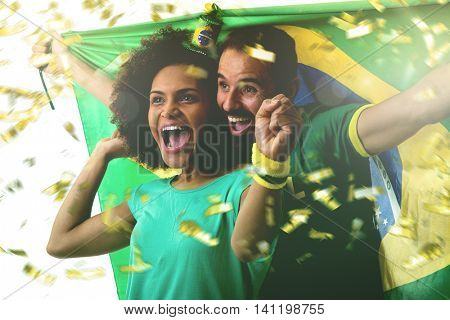 Brazilian couple fan celebrating