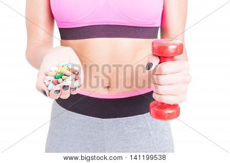 Close-up Of Girl At Gym Holding Pills And Dumbbell