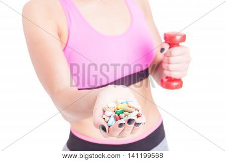 Selective Focus Of Girl Choosing Pills Over Dumbbell