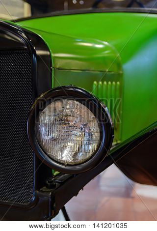 radiator and a large black lamp old green car. Retro