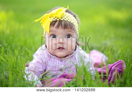 Cute Baby Girl On Green Grass
