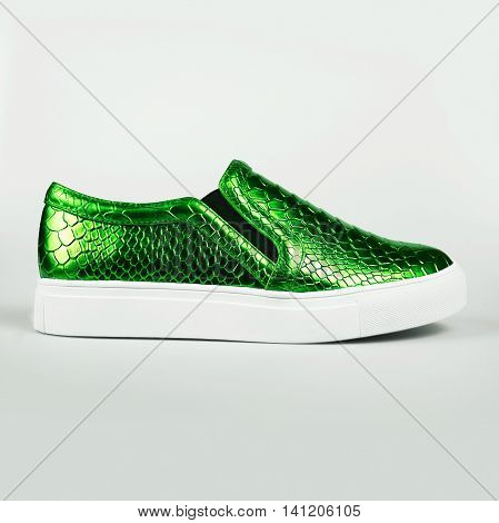 pair of new green shoes over grey