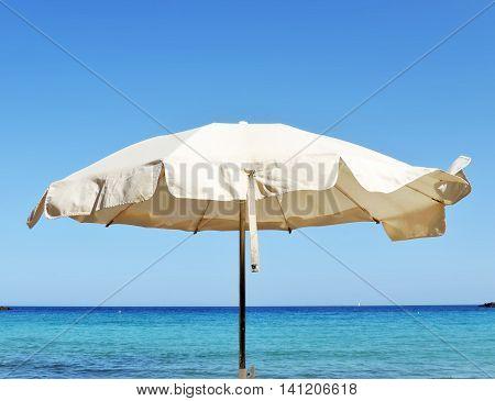 Sunshade with view to the sea. Beach scene.
