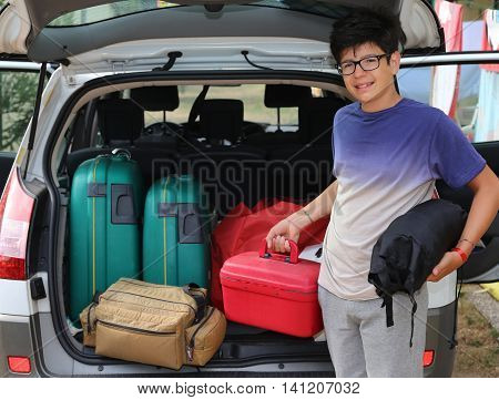 Smiling Little Boy With Glasses Loaded The Trunk