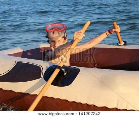 Little Girl With The Diving Mask On The Dinghy