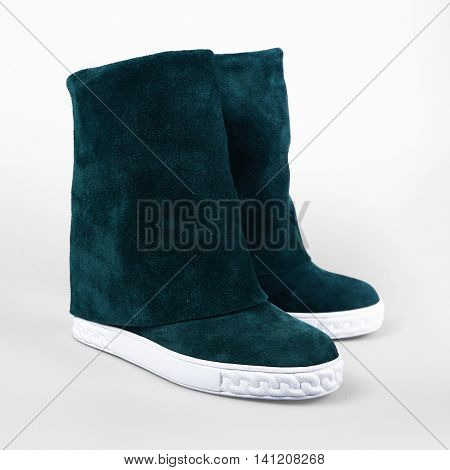 women's winter boots in a grey background