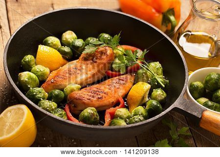 Chicken breasts cooked on the grill pan with vegetables and sesame (close up shot)