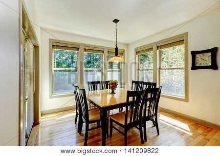 Dining Area With Wooden Table Set And Hardwood Floor