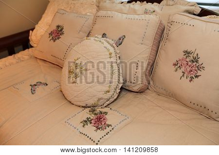 Single Wooden Bed. Close Up View Of Warm Beautiful Bedding And Pillows.