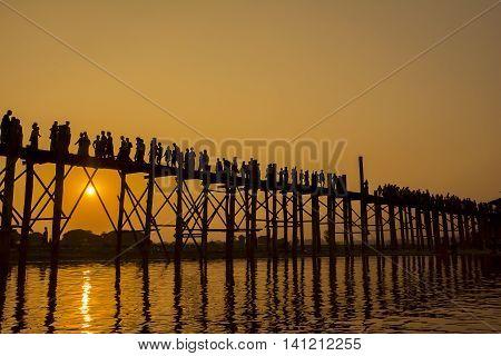 Beautiful sunset at U-Bein Bridge, Mandalay, Myanmar.