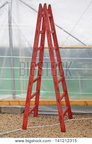 Old Style Folding Wooden Ladder at Construction Site