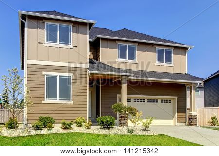 Beige And Brown Siding House Exterior.