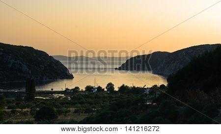 Aerial view of mediterranean coast around Porto Koufo harbor at sunset, west coast of Sithonia, Greece