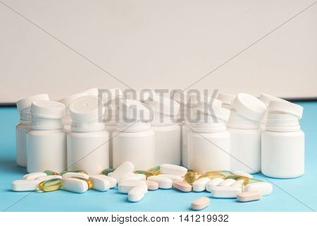 Many Pills And Tablets Isolated On Light Blue Background