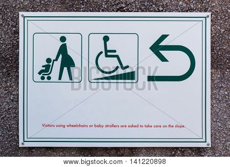 Baby Stroller Sign And Cripple Sign With Arrow For Directions.
