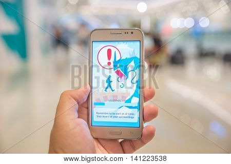 Bangkok Thailand- Ausgust 4 2016 : An Android user reads the warning screen for the new Pokemon Go app that was released on July 6 2016. It is an augmented reality mobile game for smart phones by Niantic
