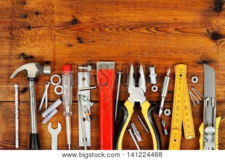 large variety of tools on wooden planks
