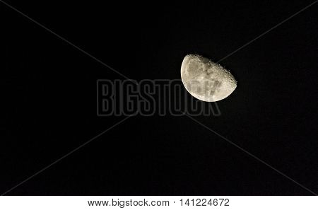 View of the Moon half full and its craters