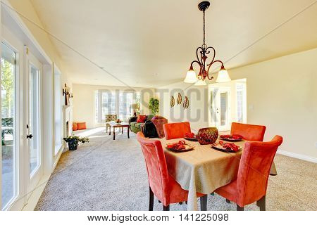 Spacious Creamy Tones Interior Of Family Room And Dining Room.