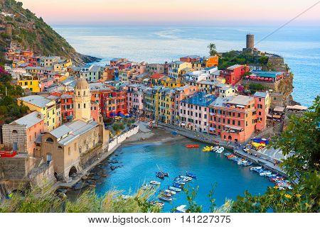 Aerial view of Vernazza fishing village at sunset, seascape in Five lands, Cinque Terre National Park, Liguria, Italy.