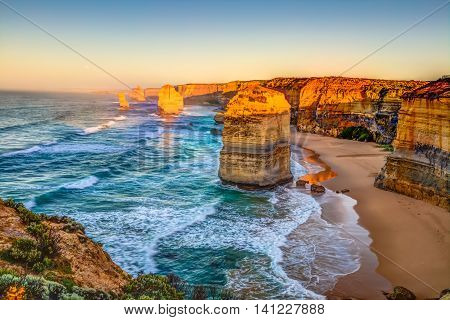 Panoramic view of the stacks that comprise the Twelve Apostles at sunset, one of the main attractions of the Port Campbell National Park. Great Ocean Road, Victoria State, Australia.