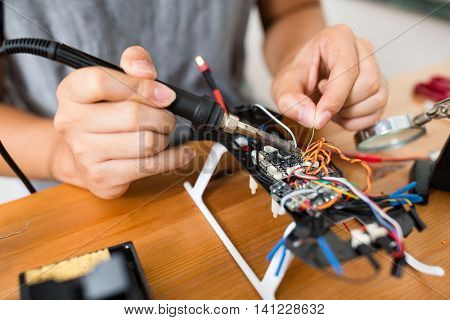 Welding wires on flying drone board